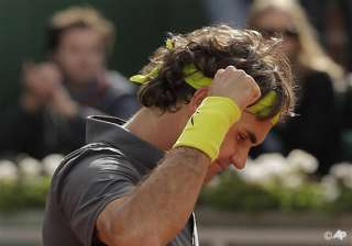 federer reaches 32nd consecutive grand slam qf -...