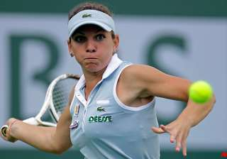 halep ousts defending champ vinci in barcelona -...