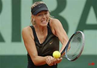 sharapova wins easily at french open - India TV
