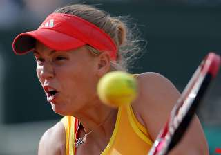 wozniacki knocked out in 3rd round of french open...