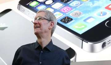 apple ceo tim cook teases reassures shareholders...