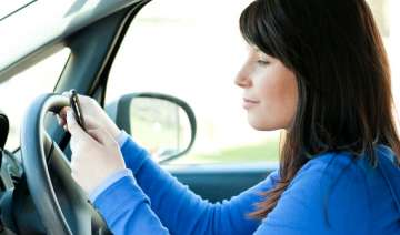 device that warns drivers from using mobiles...