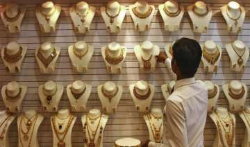 gold edges higher on stray buying silver also...