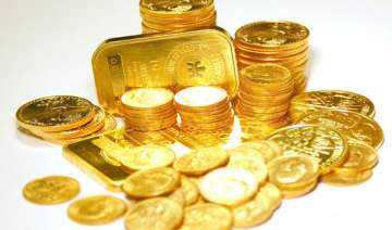 gold ends almost flat in listless trade silver...