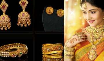 gold futures down 0.61 on global cues profit...