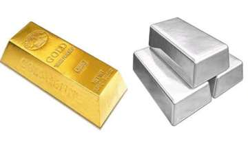 gold glitters on strong global cues silver trades...