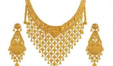 gold prices fall further by rs 130 on weak global...