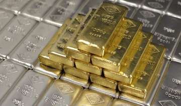 gold down by rs 100 silver up by rs 500 - India TV
