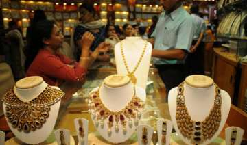 gold gains on wedding season silver sheds rs. 500...