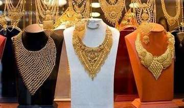 gold hits record high on global cues - India TV