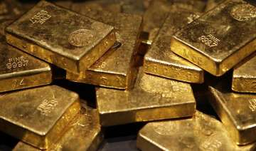 gold loses rs 100 on global cues silver gains rs...