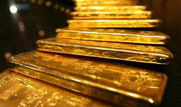 gold up by rs 75 silver down by rs 100 - India TV