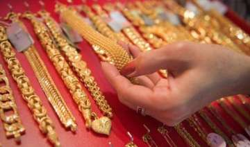 govt cuts import tariff value on gold silver -...