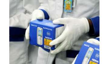 hc restrains nokia from selling transferring...