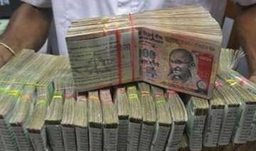 rupee down 14 paise against dollar in early trade...