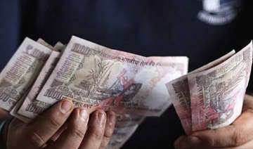 rupee trims initial losses still down 59 paise at...