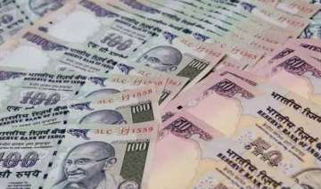 rupee up 5 paise up against dollar in early trade...