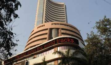 sensex cuts down losses after rbi holds rate -...