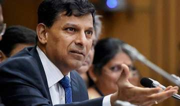 raghuram rajan leaves rates unchanged asks banks...