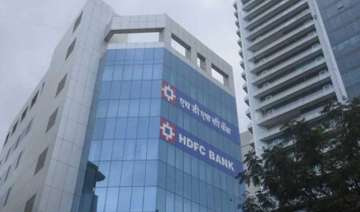 hdfc bank beats street posts 21 hike in profit -...