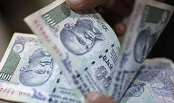 rupee breaches 64 mark hits 20 month low against...