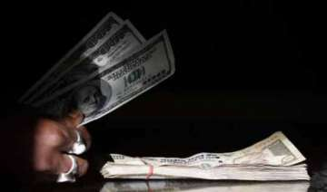 rupee plunges to over 3 month low of 63.32 vs...