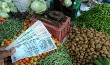 still in negative india s inflation rate dips to...