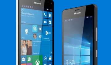 microsoft dares apple google with new devices -...