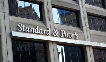 india rejects s p s warning of downgrading its...