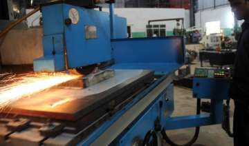 industrial output falls by 5.1 rbi may lower...