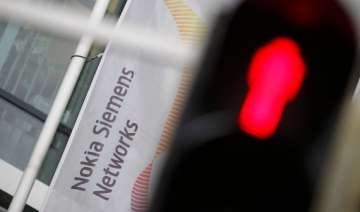 nokia downgraded by s p after nokia siemens...