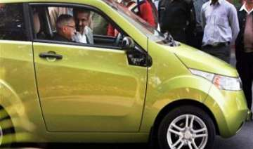 pranab sits in driving seat of mahindra electric...