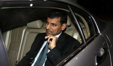 raghuram rajan hints at hike in interest rate to...