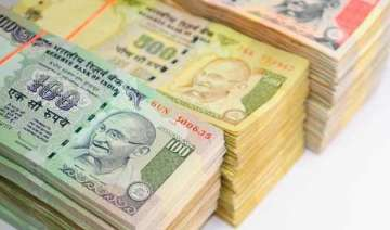 rupee closes at a historic low of 63.13 against...
