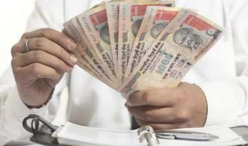 rupee gains 85 paise to 65.70 per dollar after pm...