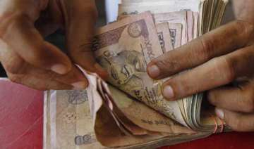rupee plunges to historic low of 64.45 vs dollar...