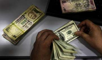 rupee drops 34 paise vs dollar in late morning...