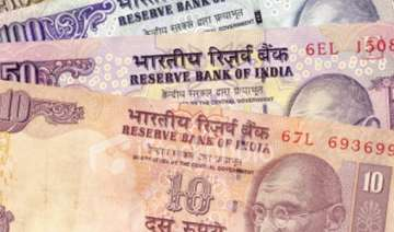 rupee up by 94 paise to 52.70/71 vs dollar on rbi...
