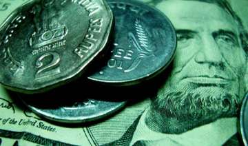 rupee touches a new lifetime low at 53.71 against...