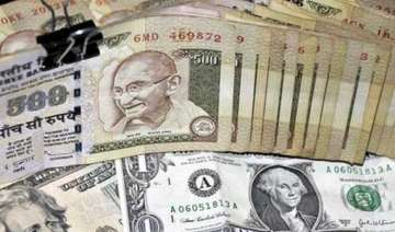 rupee gains 9 paise to 55.36 - India TV