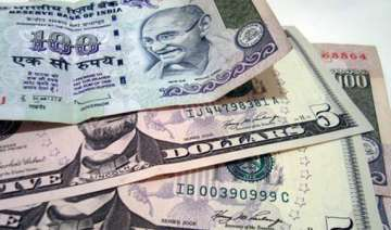 rupee slumps to record low of 57.92 - India TV
