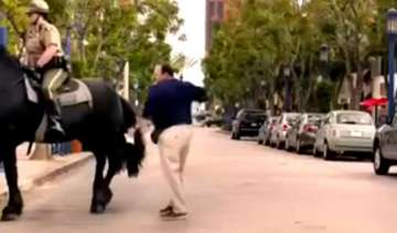 man pats horse. horse not too happy. see what...