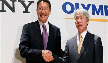 sony halves its stake with olympus - India TV