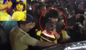watch srk protects son abram as crowd mobs them...