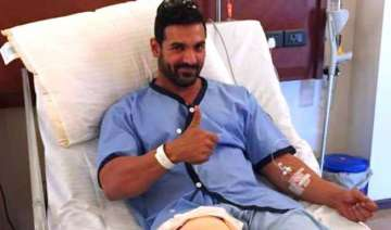 john abraham recuperating from knee injury to...
