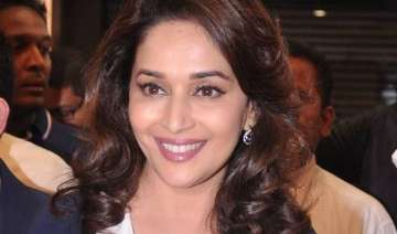 madhuri dixit rescues seven puppies - India TV