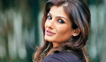 raveena tandon counters delhi heat with her red...