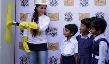 soha ali khan paints school wall to promote...
