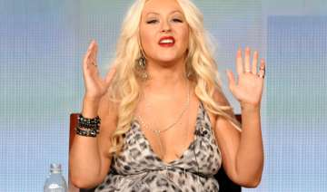 christina aguilera appears bra less to promote...