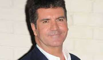 cowell shuns work to sort personal problems -...